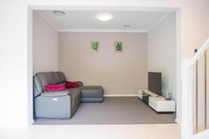 A seating area at New 5 bedroom Duplex House close to Olympic Park