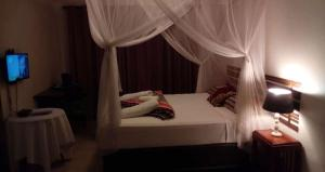 A bed or beds in a room at Acacia Guest House