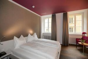Ein Bett oder Betten in einem Zimmer der Unterkunft Boutique Hotel Orchidee