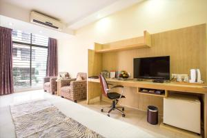 A television and/or entertainment center at Ascott The Residence Dhaka
