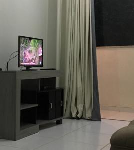 A television and/or entertainment center at Apartamento Praias do Atlantico