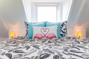 A bed or beds in a room at Aruba Boutique Apartments - Adults Only