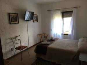 Cama o camas de una habitación en El Hotel de la Torre