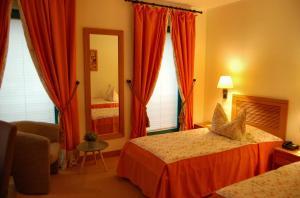 Ein Bett oder Betten in einem Zimmer der Unterkunft Albergo Hotel