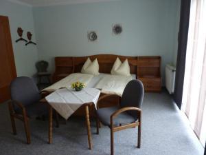 Ein Bett oder Betten in einem Zimmer der Unterkunft Haus Brigitte
