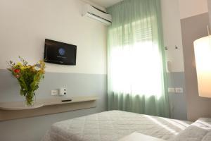 Телевизор и/или развлекательный центр в Hotel Puntabella