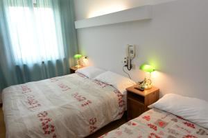 Кровать или кровати в номере Hotel Puntabella
