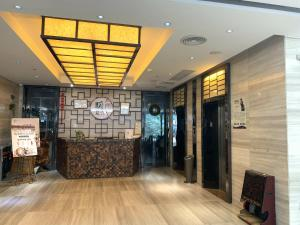 The lobby or reception area at Guangzhou Wellgold Hotel