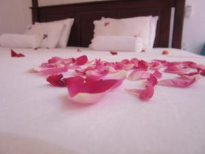 Postel nebo postele na pokoji v ubytování Sanderling Silent Beach Cabanas