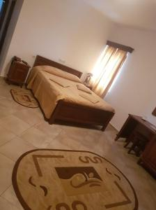 A bed or beds in a room at Hotel Etrusco
