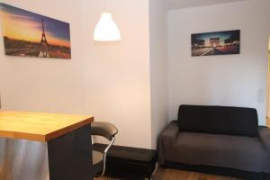 A seating area at Apartment Étoile Kleber