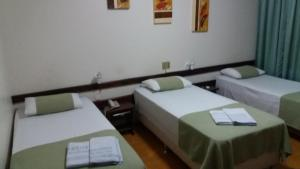A bed or beds in a room at HOTEL MARIANI