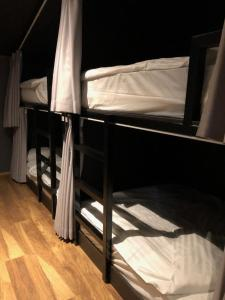 A bunk bed or bunk beds in a room at The Barn