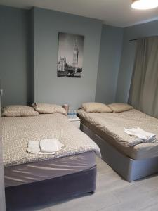 A bed or beds in a room at Cardiff Stadium Guest House