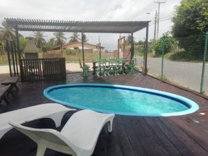 The swimming pool at or close to Pousada Caminho do Porto