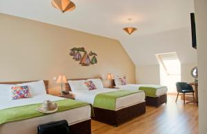 A bed or beds in a room at Kinvara Guesthouse