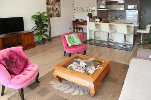 Coin salon dans l'établissement Residence Tahiri Appartement vue mer