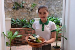 Staff members at Mekong Riverview Hotel