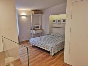 A bed or beds in a room at Loft Bellavista Volterra