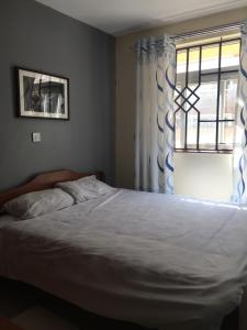 A bed or beds in a room at KRis place