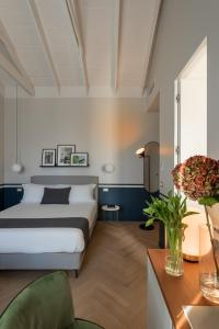 A bed or beds in a room at Velvet Grey Boutique Hotel
