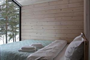 A bed or beds in a room at Eco Mini-Hotel Alteria