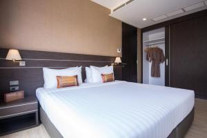 เตียงในห้องที่ Amanta Hotel Nongkhai