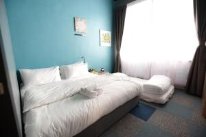 A bed or beds in a room at Vibrant Hostel
