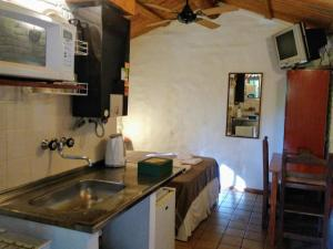 A kitchen or kitchenette at Cabañas Los Hornillos