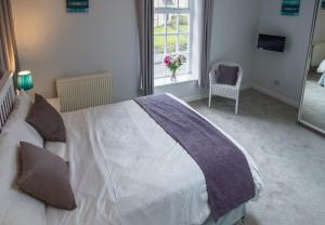 A bed or beds in a room at The Victoria Walshaw