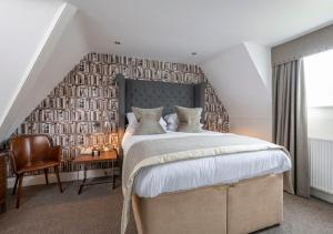 A bed or beds in a room at The Lovat, Loch Ness