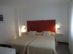 A bed or beds in a room at Hostel Soria