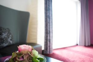 Ein Bett oder Betten in einem Zimmer der Unterkunft Hotel Fauna