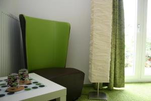 Ein Sitzbereich in der Unterkunft Hotel Fauna