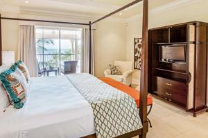A bed or beds in a room at The Landings Resort and Spa - All Suites