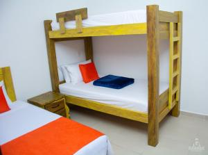 A bunk bed or bunk beds in a room at Hotel Madre Laura Jericó
