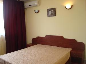 Un pat sau paturi într-o cameră la Hotel Terra