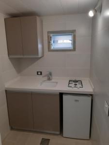 A bathroom at Bauhaus Chalets Apartment