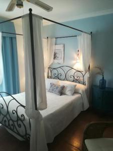 Cama o camas de una habitación en Hostal Boutique Macavi