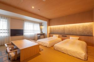 A bed or beds in a room at Lime Resort Myoko