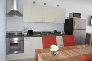 A cozinha ou cozinha compacta de Whitehouse Lagun Apartments