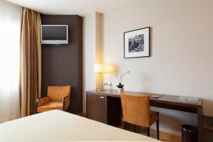 Кровать или кровати в номере Hotel FC Villalba
