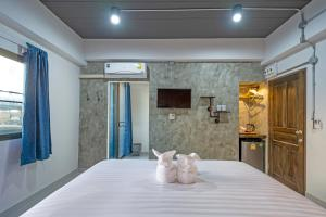 A bed or beds in a room at BA Apartment FlowSuvarnabhumi