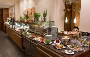 Breakfast options available to guests at Hotel Süd art