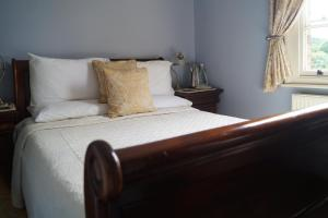 A bed or beds in a room at Foundry Masters House