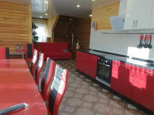 A kitchen or kitchenette at Tsarskaya Usad`ba Guest House