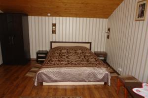 Кровать или кровати в номере Агроусадьба Несвижская