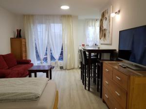 Ein Sitzbereich in der Unterkunft Apartment Metzingen City