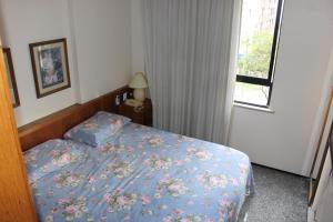 A bed or beds in a room at Flat Abolicao