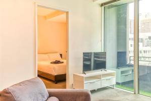 A television and/or entertainment center at CBD, Collins St address, near Southern Cross - 2 beds